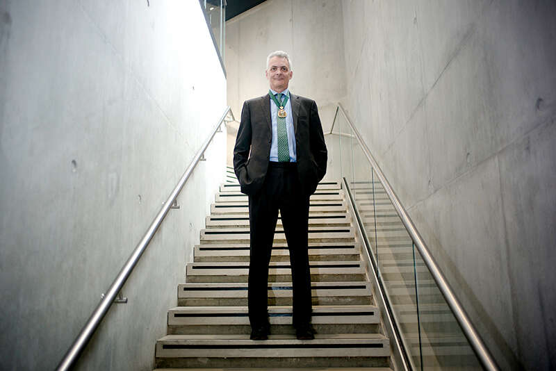Jonathan Flint, CBE, standing in stairwell at IOP building